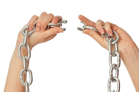 perversion: woman tearing a heavy chain by hands as a symbol of freedom