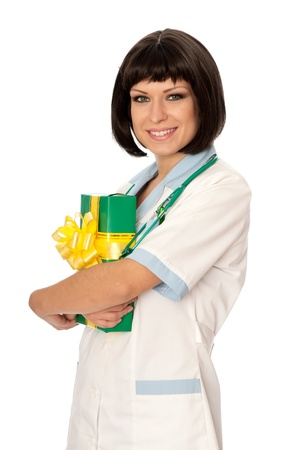 doctor holding gift: The doctor holding a gift from patient in the hand