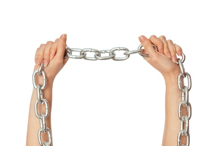 woman breaking the chain by hands for liberation as a symbol of captivity photo