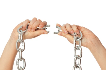 woman tearing a heavy chain by hands as a symbol of freedom Stock Photo - 9025825