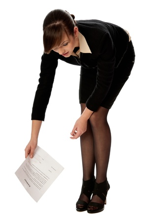 signing authority: Officer collecting important papers from the floor Stock Photo