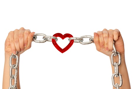 woman holding in the hands chain with heart as a  symbol of strong love Stock Photo