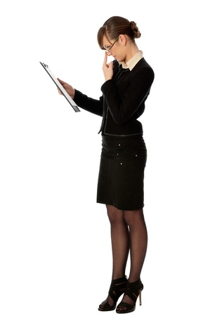 signing authority: General director reading a contract for her partner