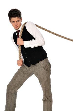 strong-willed man pulling of a rope and wins as a symbol of success photo