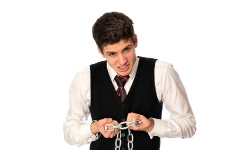 businessman breaking the chain by hands for liberation as a symbol of work captivity Stock Photo - 9321547