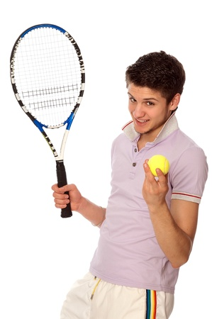 man with racket concentrated on playing tennis and preparing for the ball serving photo