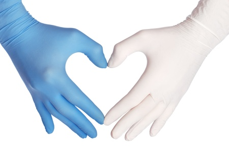 medic: cardiologist in blue and white gloves saving life of all his patients