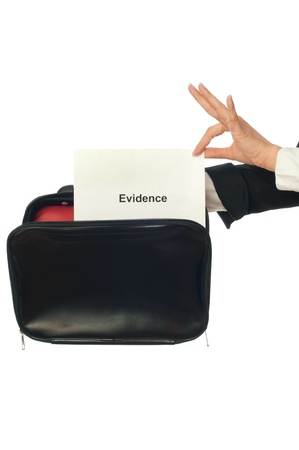 Investigator examines in details the materials of evidence reported by advocate photo