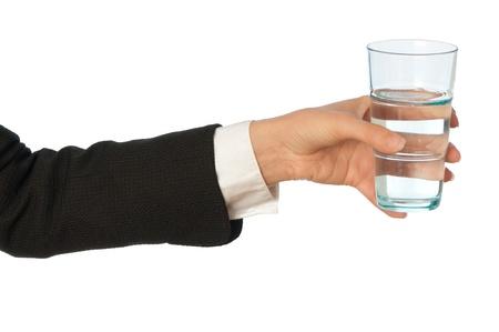 pellucid: mujer con un vaso con agua en la mano en la rotura de negocio Foto de archivo