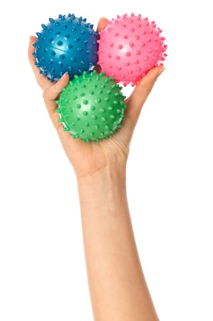 Mother stretches three colored massage balls for the children's hands development to her baby Stock Photo - 10388074