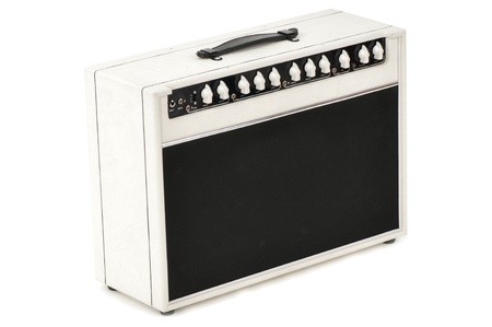 white guitar combo amplifier for the bass guitarist of popular musical group Stock Photo - 10632113