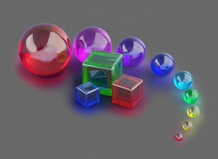 red, blue and green glass cubes and colorful marble balls photo