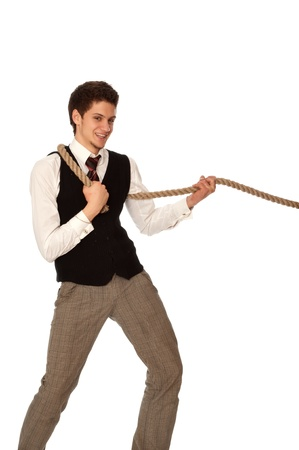 strong-willed man pulling of a rope and wins as a symbol of success Stock Photo - 11274231