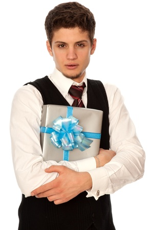 handsome man holding in the hands the gray box with blue ribbon as a gift for his girlfriend photo