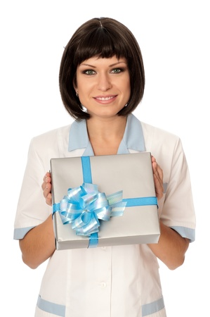 doctor holding gift: The doctor holding a gift for patient in the hand Stock Photo
