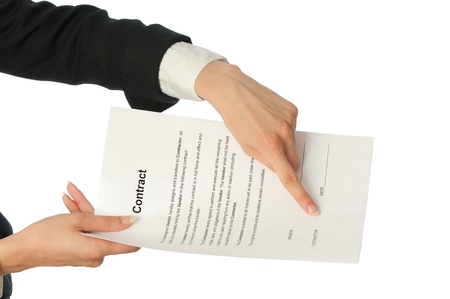 signing authority: The managing director giving her partner a contract for signing Stock Photo