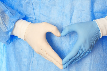 cardiologist in blue and white gloves saving life of all his patients