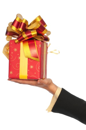 woman giving a red box with yellow bow as a gift photo
