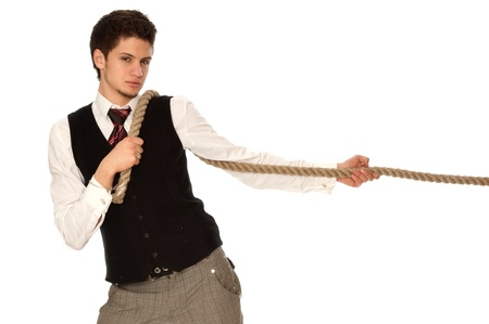 strong-willed man pulling of a rope and wins as a symbol of business success Stock Photo - 12552851