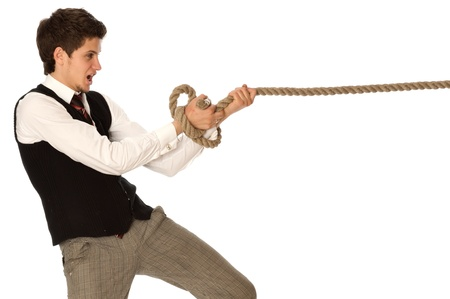 strong-willed man pulling of a rope and wins as a symbol of business success Stock Photo