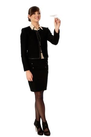 Businesswoman throwing white paper plane on the break photo