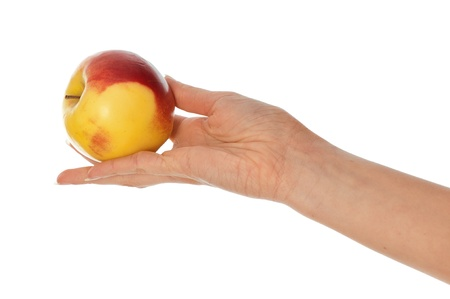 corroboration: woman holding in the hand one fresh yellow with red-edged apple