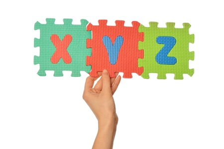 teacher holding in the hand the amusing colored educational puzzles with alphabet Stock Photo - 15605739