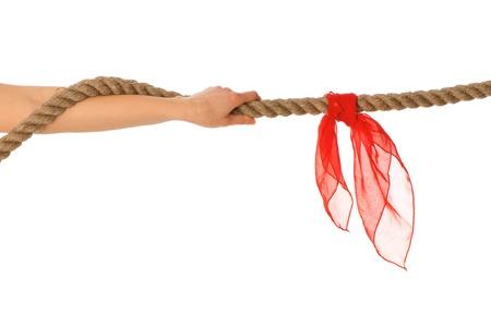 Die willensstarke Frau Stücke Ziehen eines Seils und gewinnt