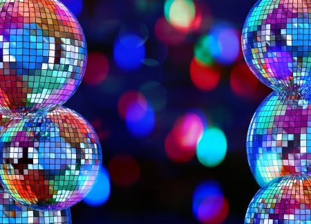 Colorful dark funky background with mirrored glitter disco balls for party