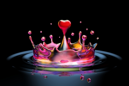 falling heart shaped water drop into the water on the dark background Stock Photo - 16928690