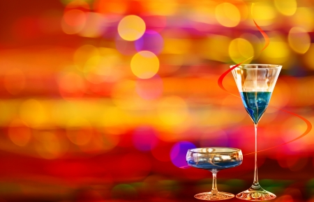 Two blue cocktails with curacao on the background with various colors of illumination of the night city Stock Photo - 18144453
