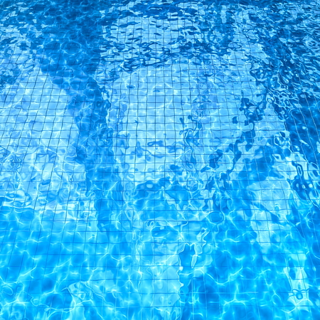 caustic: swimming pool with sun glare and optical caustic network on the water