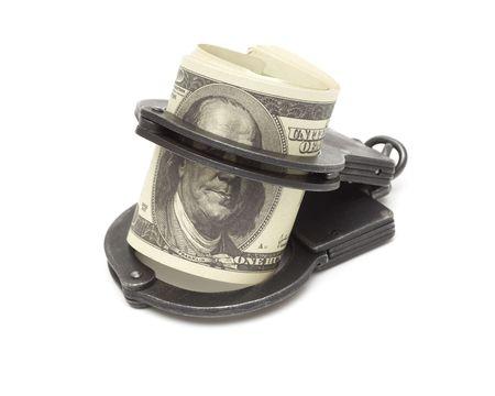 manacles: Dinero y esposas aislados sobre fondo blanco