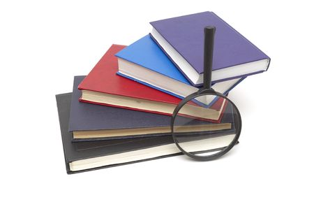 scientific literature: Stack of books and magnifying glass isolated on white background Stock Photo