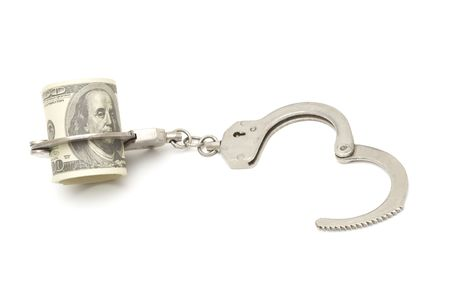 snitches: Money and manacles isolated on white background