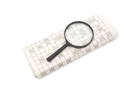 Magnifying glass over a newspaper classified section Stock Photo - 6788383
