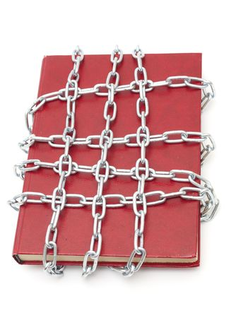 Censorship concept with book and chains on white photo