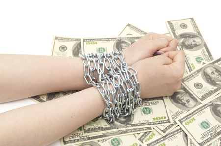 debt goals: hands with dollar are bound by chain