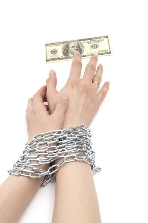 hands with dollar are bound by chain Stock Photo - 6786322