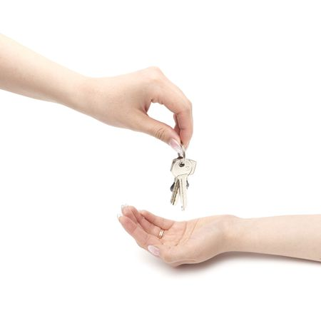 Hands and key isolated on white background photo