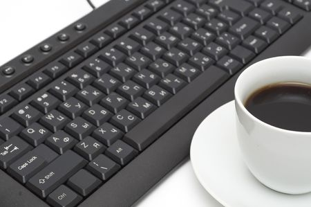 buchstabe: cup of coffee and black keyboard