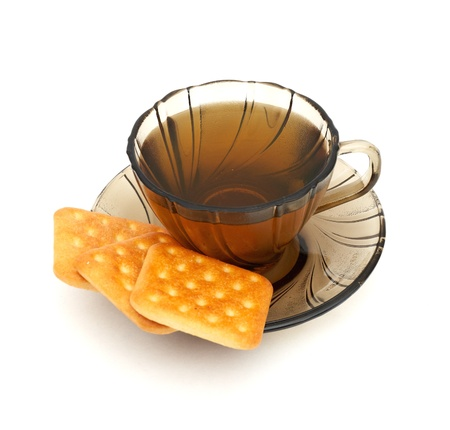 cup of tea and some cookies on white background Stock Photo - 8358380