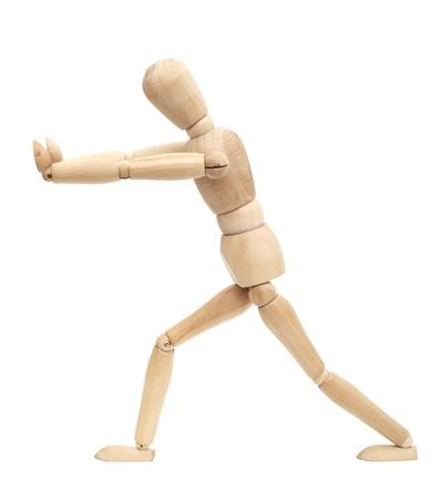 marioneta de madera: Figura de madera caminar aislado sobre fondo blanco