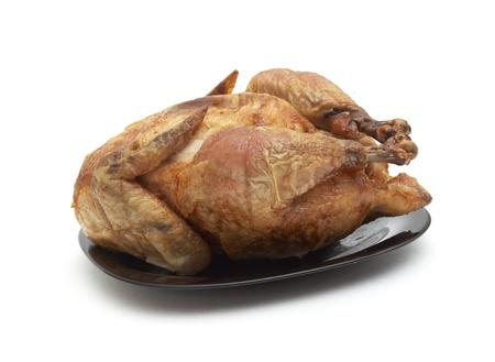 Tasty Crispy Roast Chicken on black plate . Stock Photo - 8413462