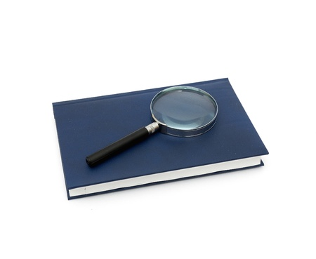 magnifier and book isolated on a white background Stock Photo - 8413774