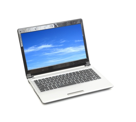 minicomputer: blue sky in laptop isolated on white background(sky is my photo)