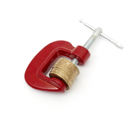 Money clamped in the clamp on a white background. (isolated) photo