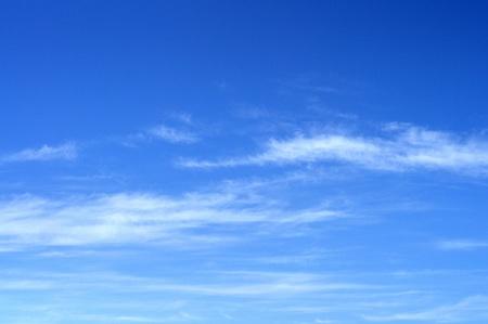 cloud drift: clouds in the sky drifting away in a light breeze
