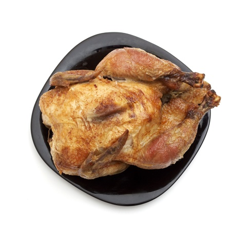 Tasty Crispy Roast Chicken on black plate . Stock Photo - 8439259