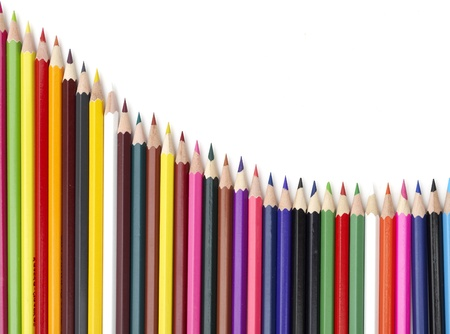 Color pencils in arrange in color isolated photo